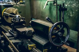 A Lathe Allows The Creation Of Many  Useful Items Including New Tool Handles in a home woodwork shop